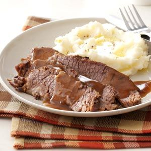 Sunday Dinner Brisket Recipe -We loved how tender this brisket came out of the slow cooker. The sauce has a robust, beefy flavor with a slight tang from the balsamic vinegar, and the  rich caramelized onions complete the dish.—Taste of Home Test Kitchen