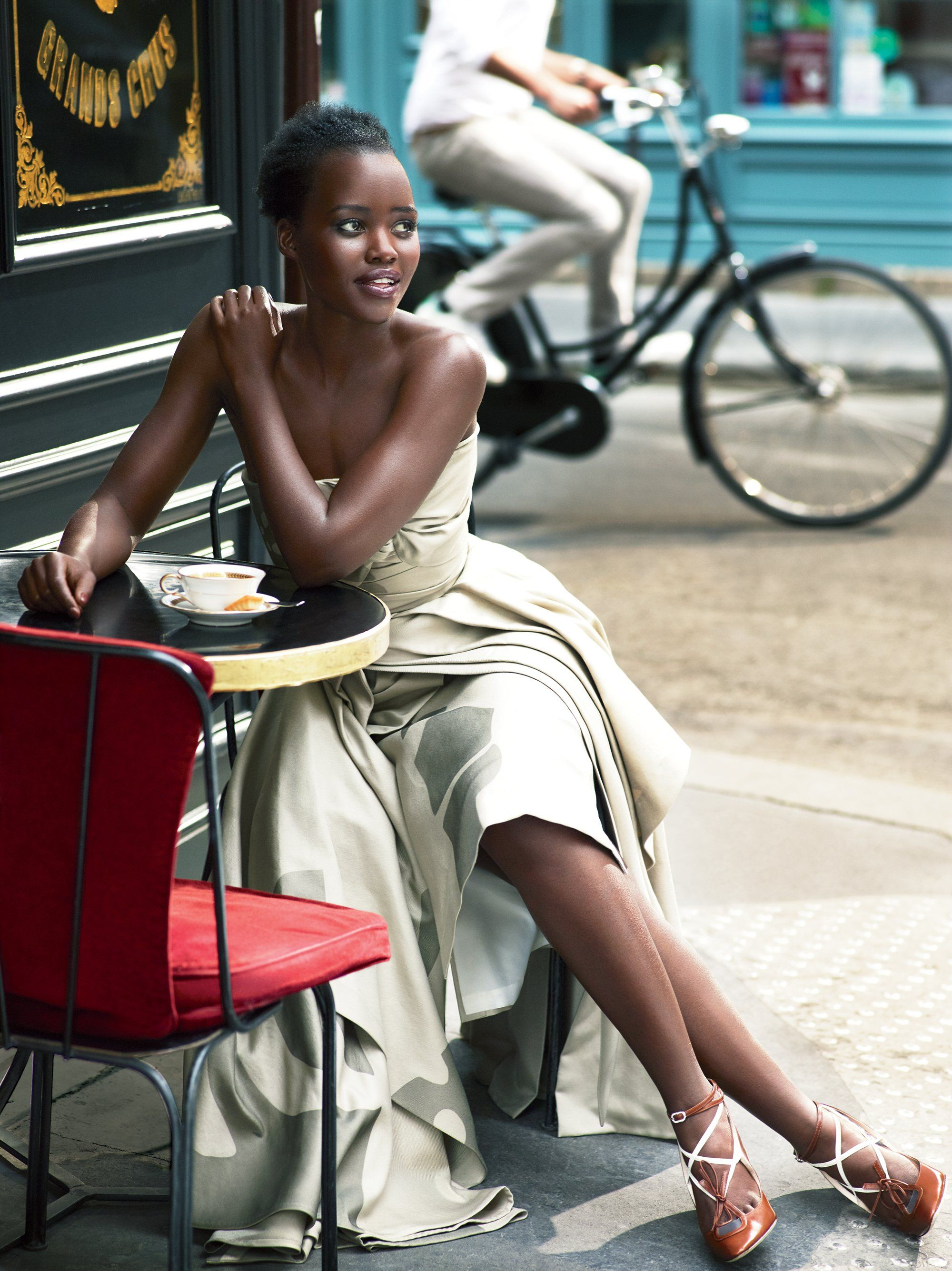 "Café Society - ""When you know a dress is handmade, it completely changes the experience of wearing it,"" says Lupita of attending her first couture shows. Maison Margiela ""Artisanal"" designed by John Galliano dress and heels.   Photographed at Da Rosa"