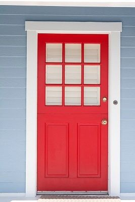 Red door framed with white trim and light blue siding | Addition ...