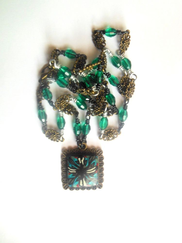 Bronze, green colournabstract flower polymer clay necklace with glass beads.