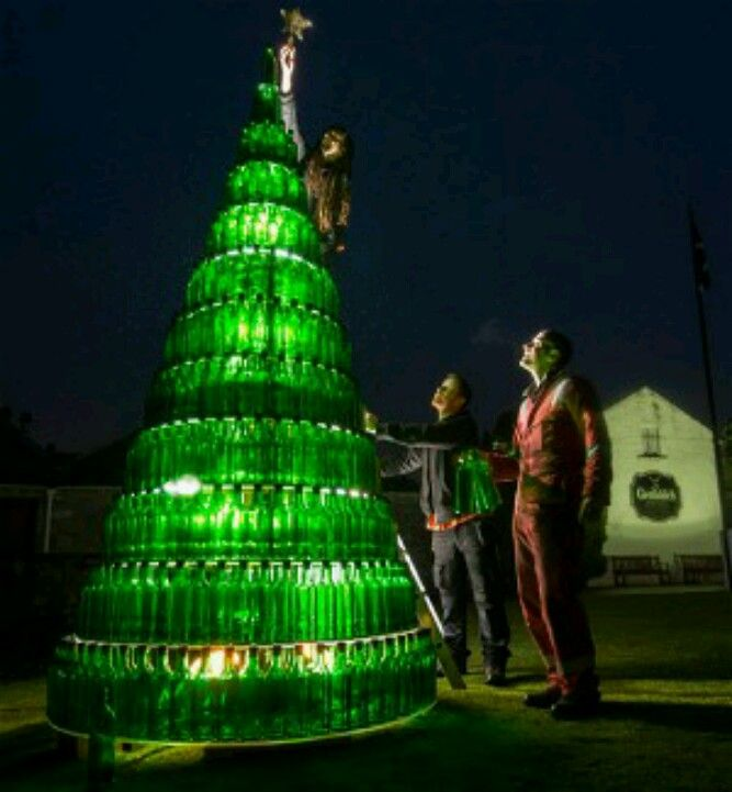 A Christmas tree made of 665 Glenfiddich bottles is installed at the