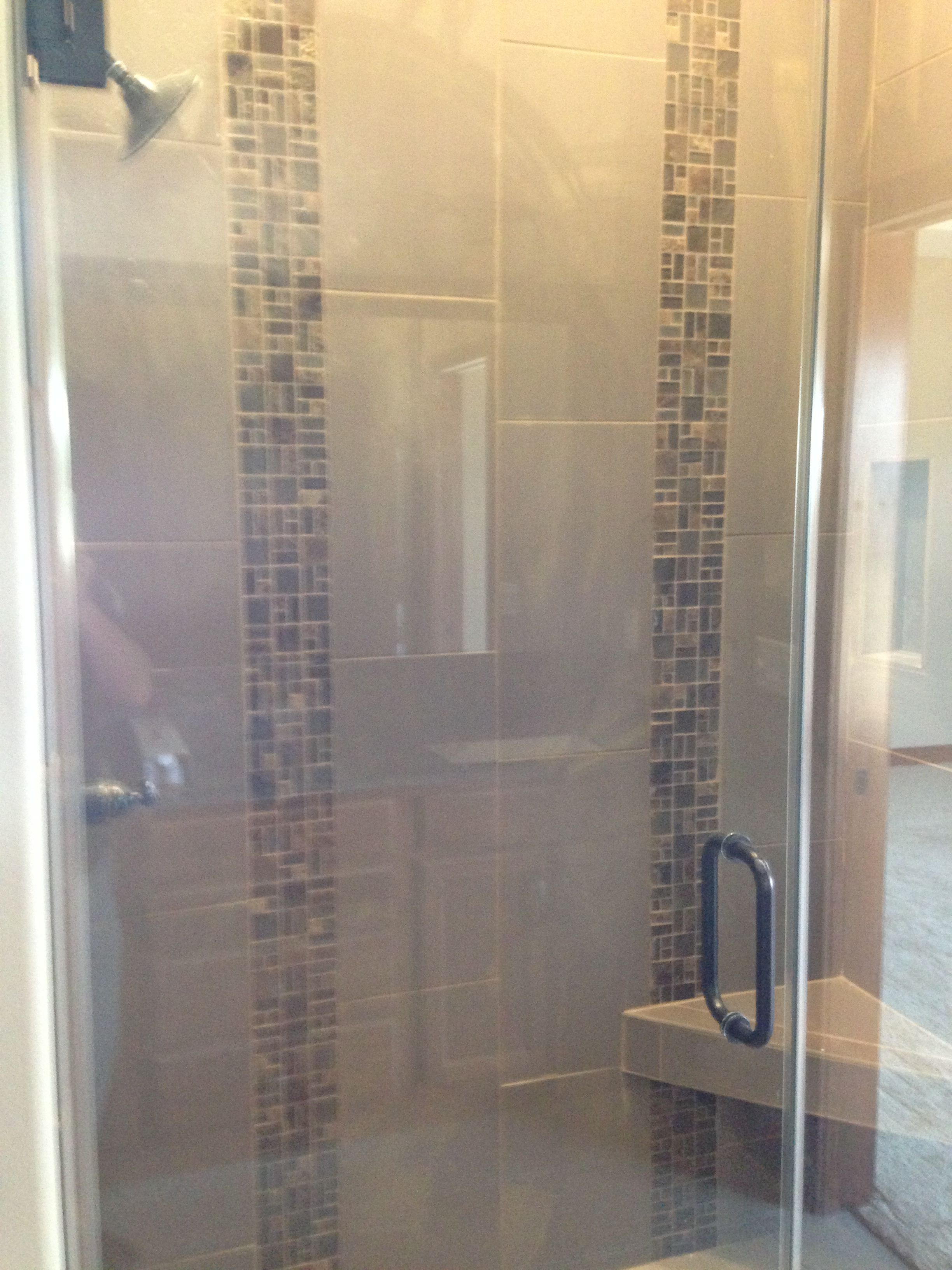 use rectangular tiles vertically to heighten a shower | for the