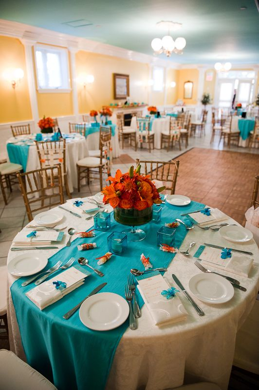 i like the turquoise table runner and then substitute the middle with a mason jar with coral