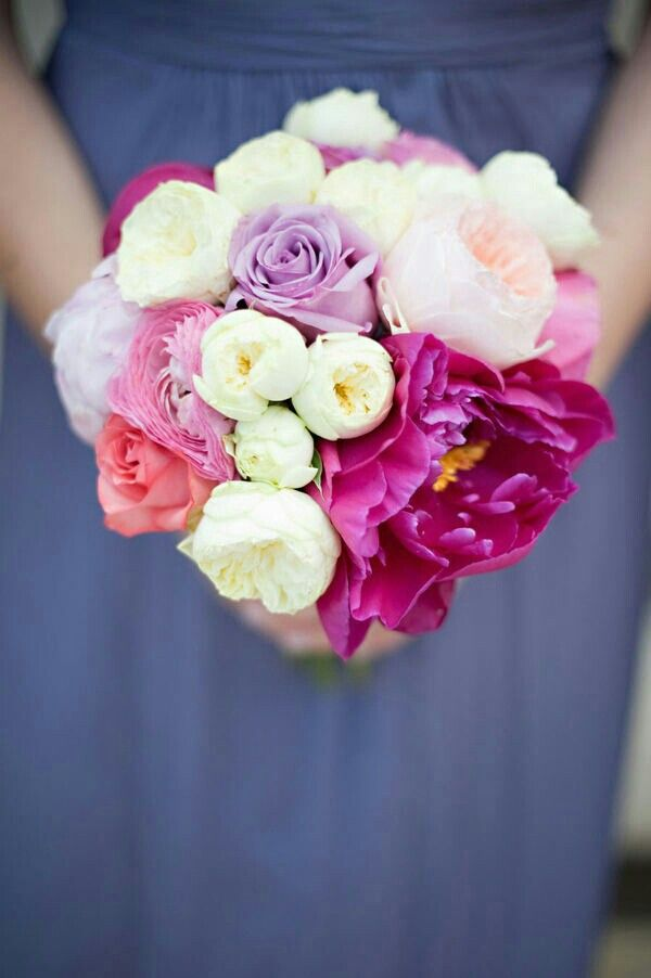 Bridesmaid's Pretty Bouquet Showcasing: White English Garden Roses, Peach English Garden Roses, Coral Roses, Pink Ranunculus, Violet Roses, Fuchsia Peonies