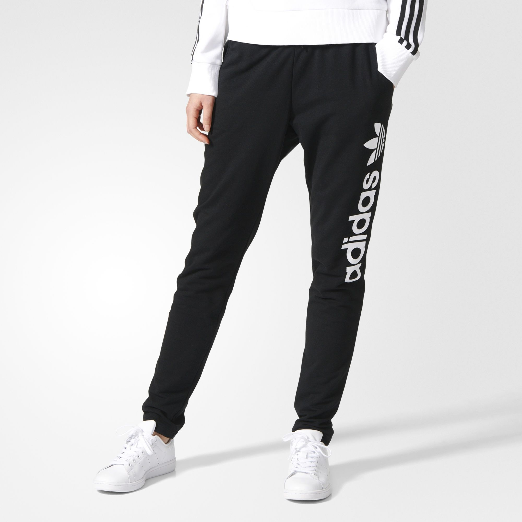 An essential style made with extra-soft French terry, these women's track  pants have a modern tapered shape. Lightweight and soft, they have a bold  linear ...
