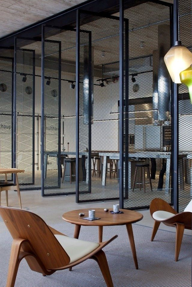 modern open plan interior office space. mesh screens in industrial open plan office modern interior space r