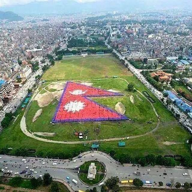 World Largest Human National Flag of Nepal - 35,000 Nepalese people gathered for this event today 23 august, 2014 at tundikhel.   http://bit.ly/1t2l9K8