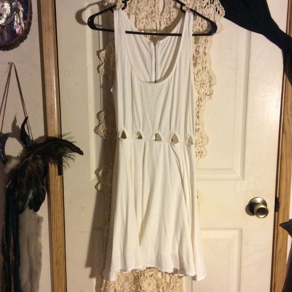 White skater type dress In GUC, white with cut outs around waist and the bottom flares a bit. Very cute on. Dresses