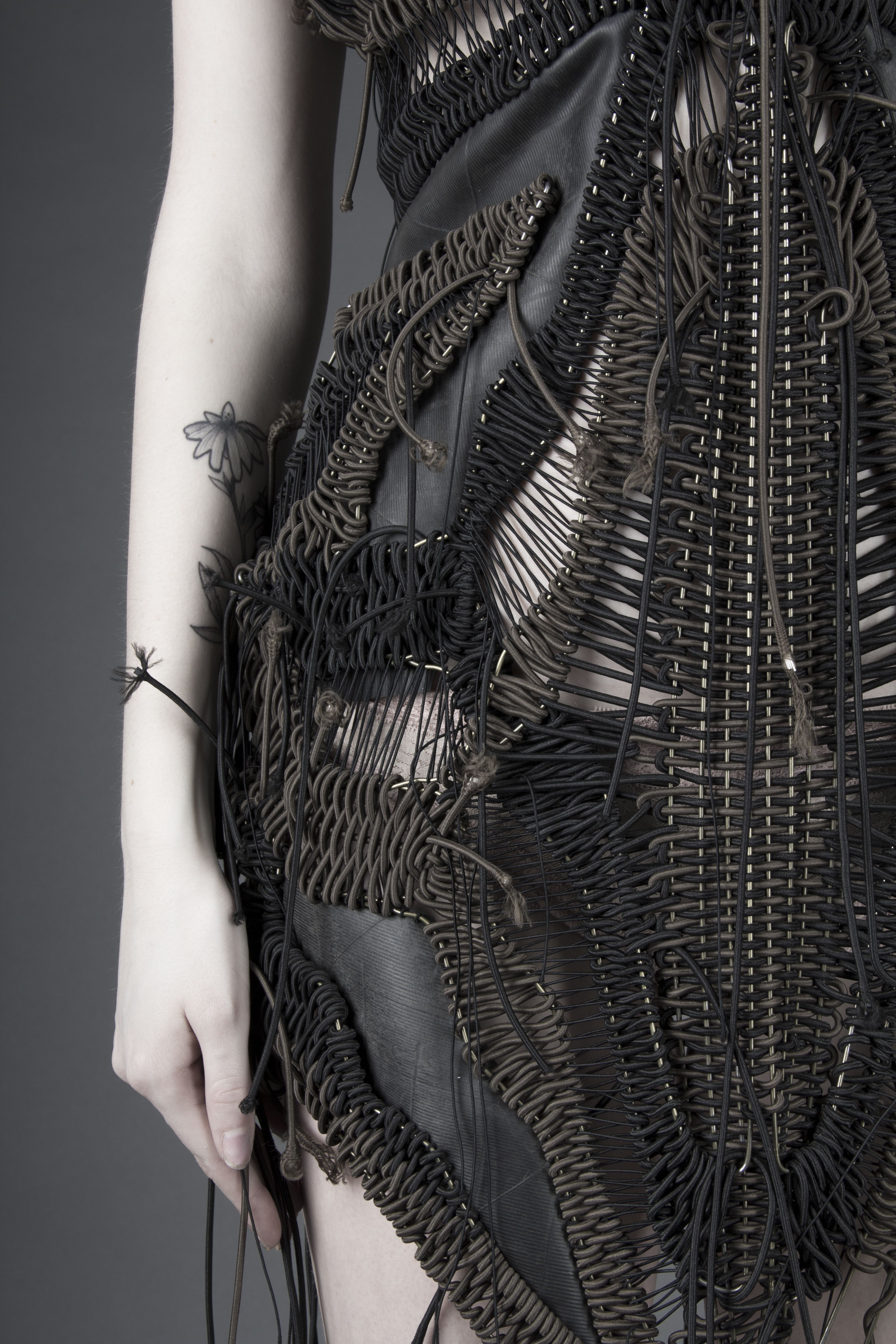 Design by Ellie Lindholm. Recycled tire, wire hangers, and elastic ...