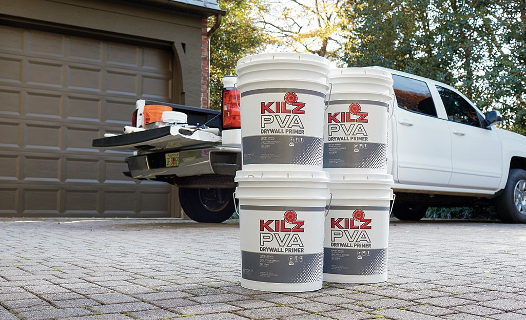 Four Buckets Of Primer Placed On A Driveway Next To A Pickup Truck Priming Walls Paint Sheen Paint Job
