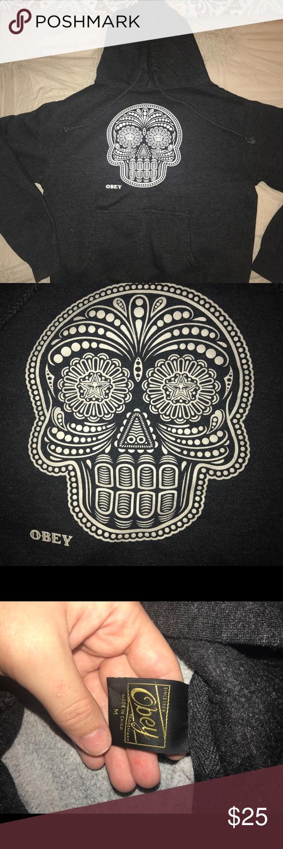 obey hoodie dark grey/almost black Obey hoodie. skull glows in the dark. great condition Obey Tops Sweatshirts & Hoodies