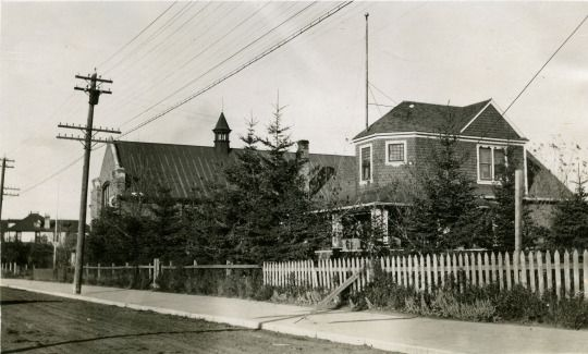 The east side of Gaetz Avenue, looking north from 54th Street. The buildings left to right are Leonard Gaetz House (later owned by G.W. Smith). the St. Luke's Anglican Parish Hall and Moira Villa, home of Captain Cottingham. c. 1910.