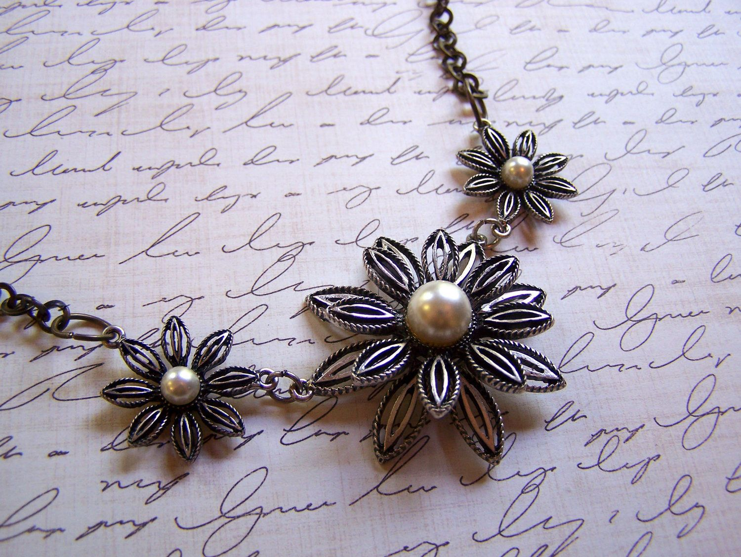 Vintage Inspired Silver Metal Flower Trio and Faux Pearl Statement Necklace. $22.00, via Etsy.