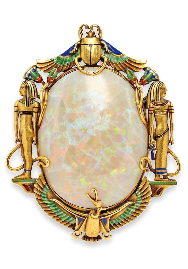 Egyptian Revival. 14kt Gold, Opal, and Enamel Brooch, Marcus & Co., the opal framed by ancient Egyptian motifs with enamel accents.: