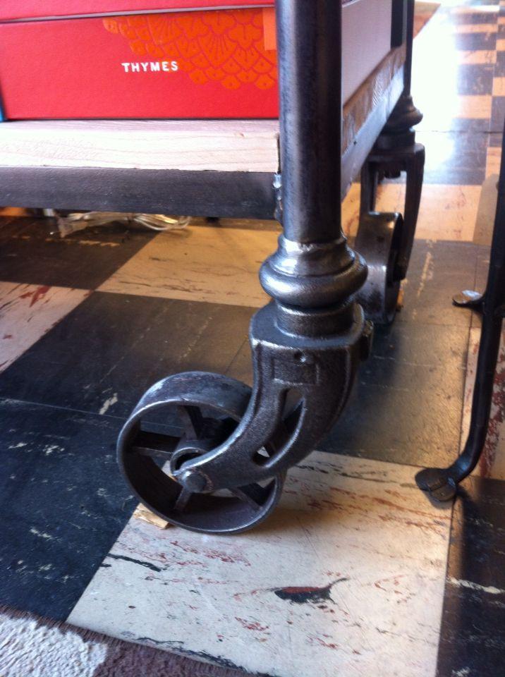 Wheel detail on industrial/rustic shelves