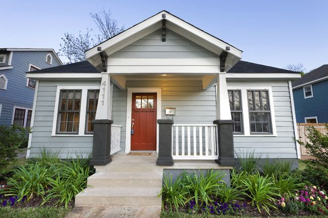 Light Gray Exteriors A light gray Craftsman home with white