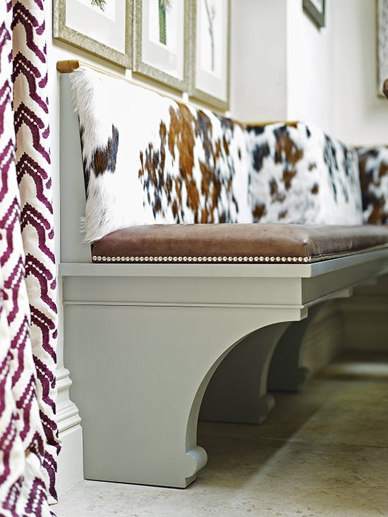 This Bespoke Bench Features Curved Support Brackets And Cushions