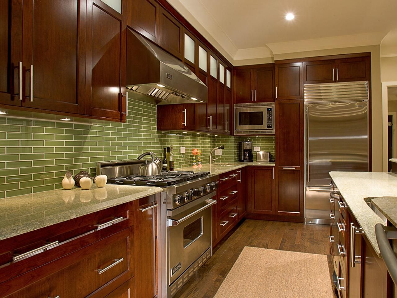 The light green Green Coast granite countertops complement the ...