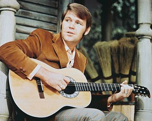 """Welcome to Music Friday. Today Glen Campbell delivers his rendition of Conway Twitty's hit, """"It's Only Make Believe."""" In this song about unrequited love, Campbell pours out his heart in a soaring vocal performance that includes a key jewelry reference: """"My hopes, my dreams come true / My life, I'd give for you / My heart, a wedding ring / My all, my everything."""" Video at link."""