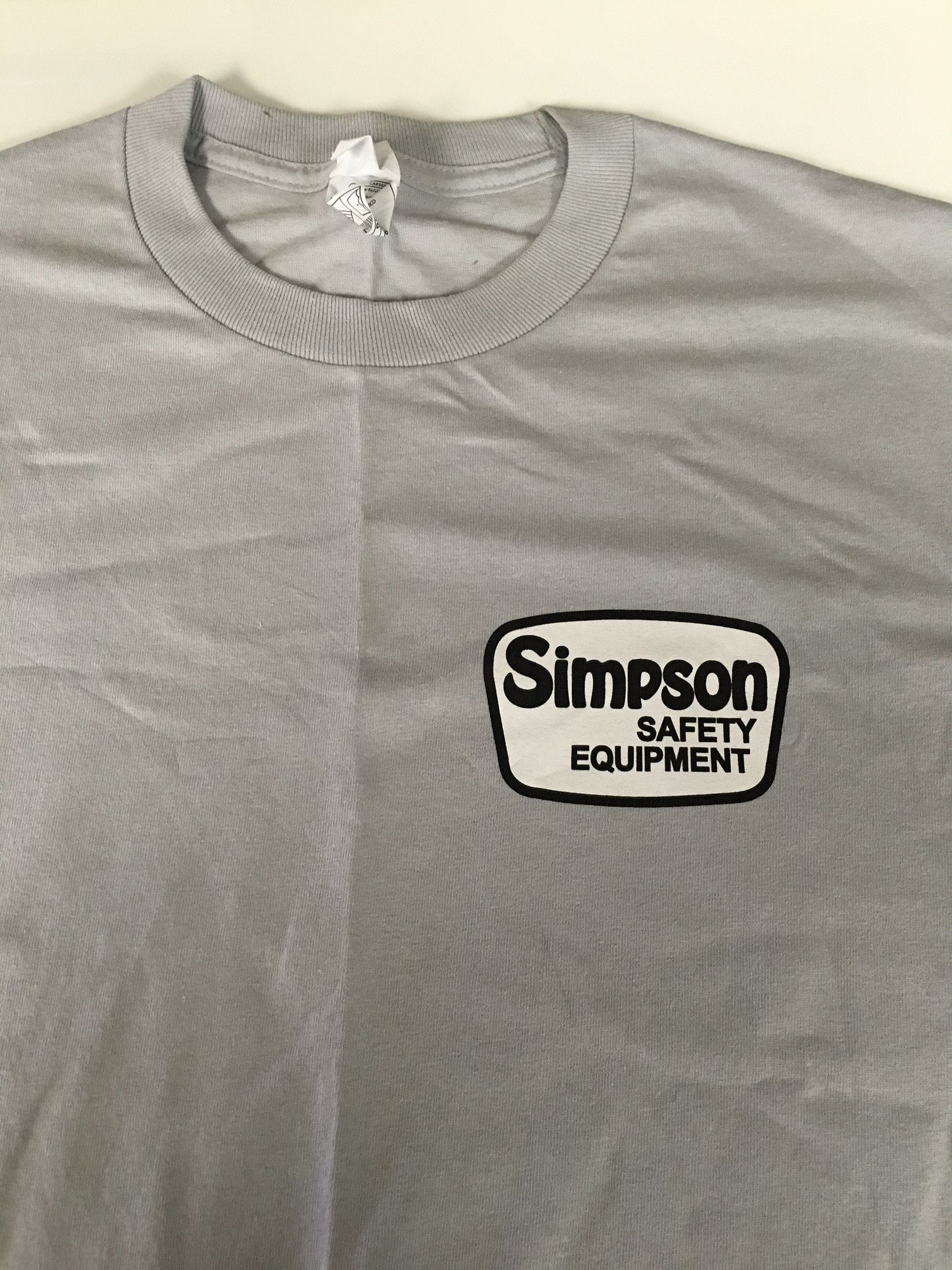 6362e134 Simpson Drag Chute T-Shirt Grey. #@kickmotorsport #newarrival #retro  #simpson #simpsonathlete #simpsonhelmets #treatyourself #zenithiscoming