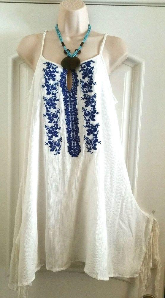 a1e9fdf8f1597 White embroidered mexican style tunic bohemian dress L+Anthropologie  earrings #MORALFIBER #AsymmetricalHem