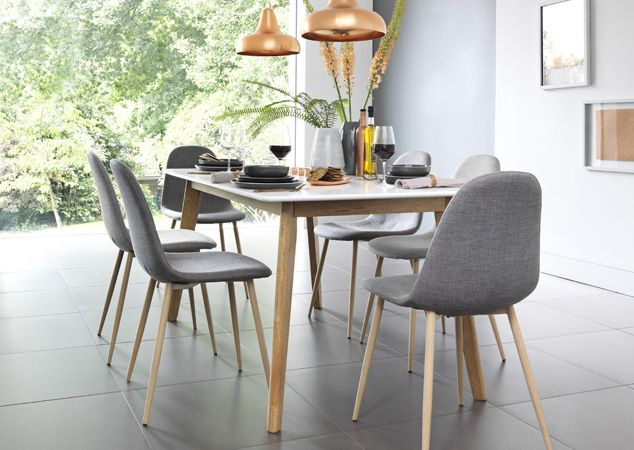 Light Blonde Wood Table With Grey And Green Upholstered Chairs In Scandinavian Inspired Dining Room Home Green Upholstered Chair Chair Cushions