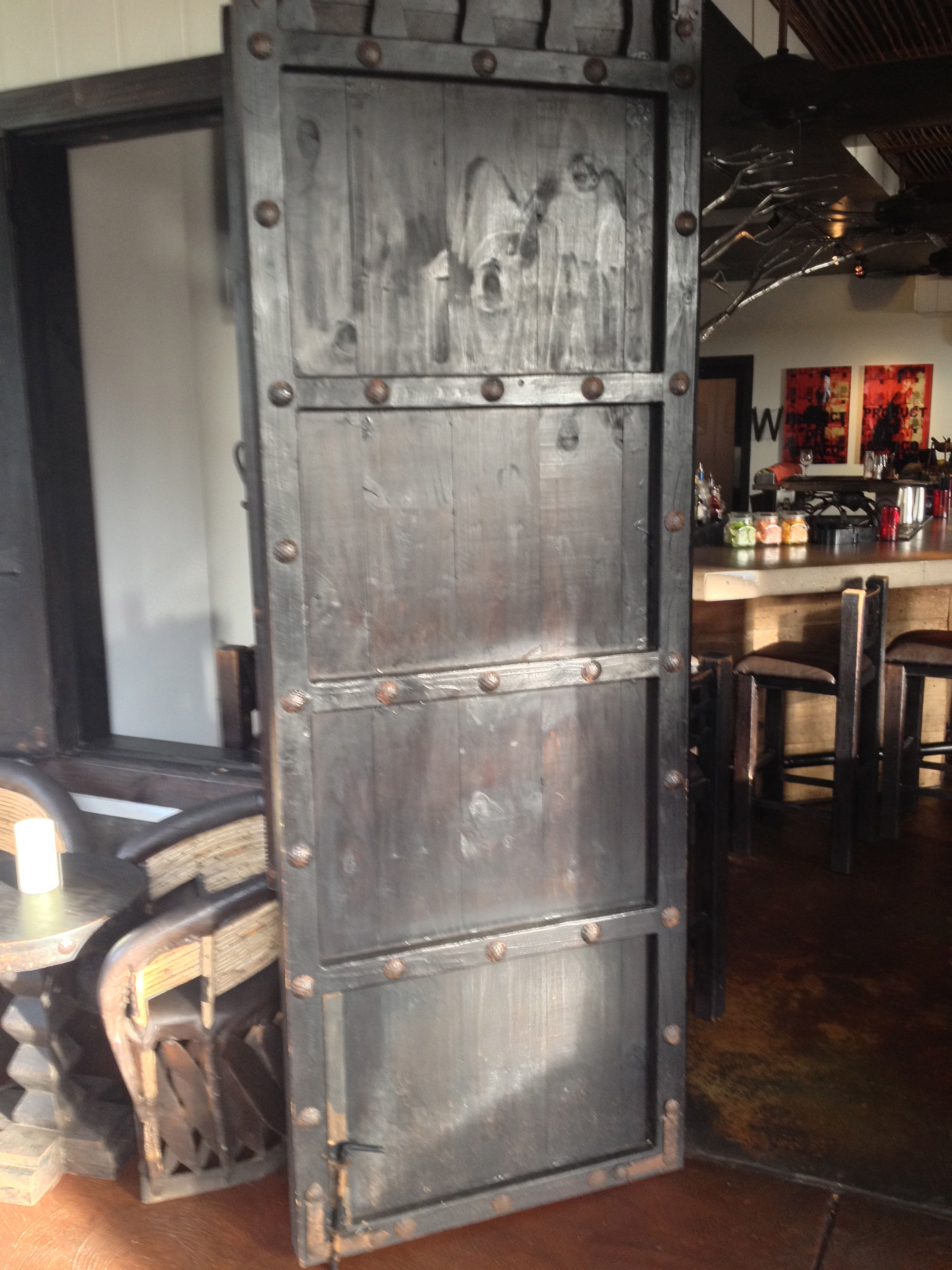 Amazing Pallet Wood Barn Door With Metal Rivets And Stained Black With A Bit Of Red.