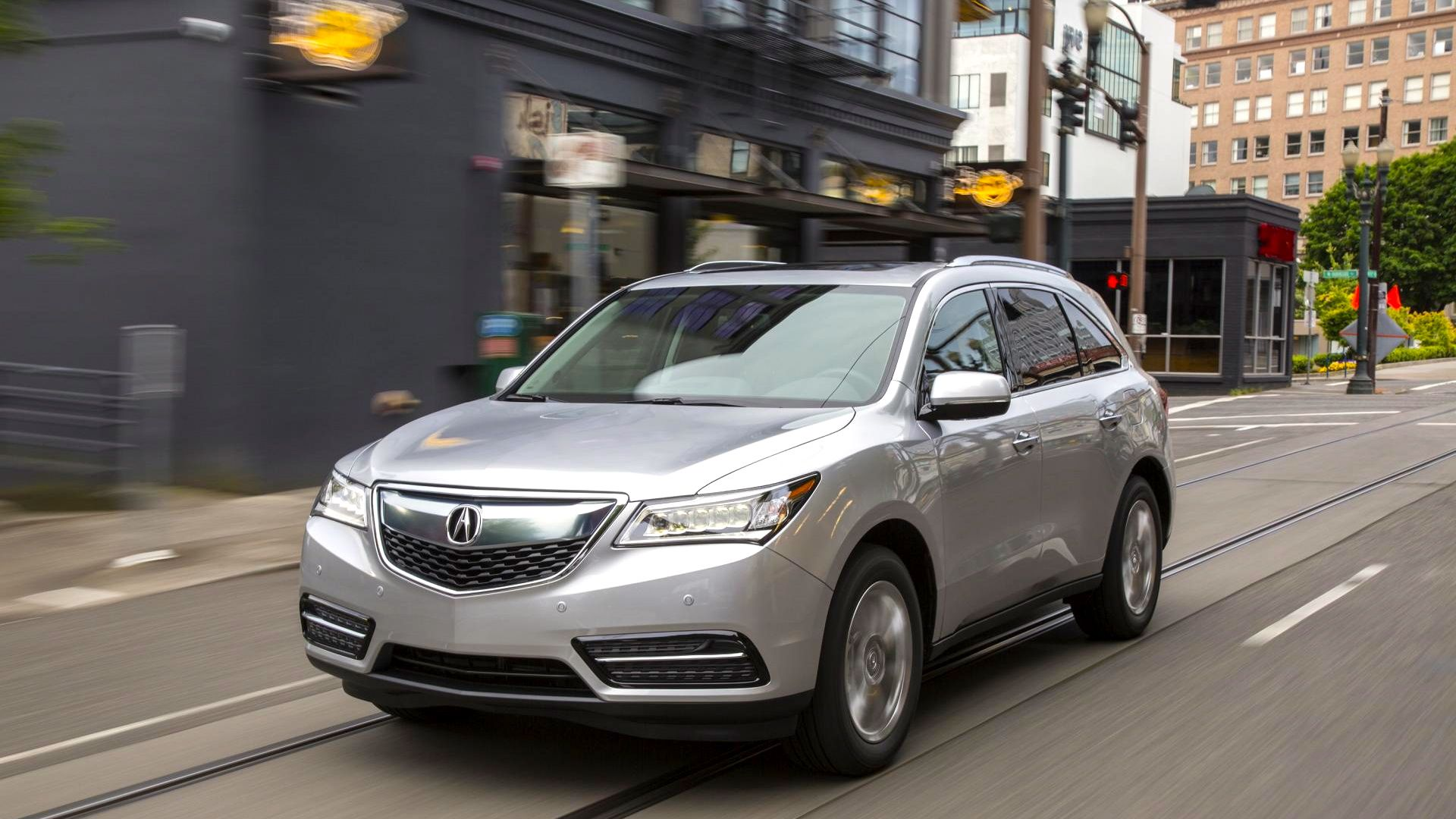 2015 Acura MDX gray rear to side view exterior driving sun