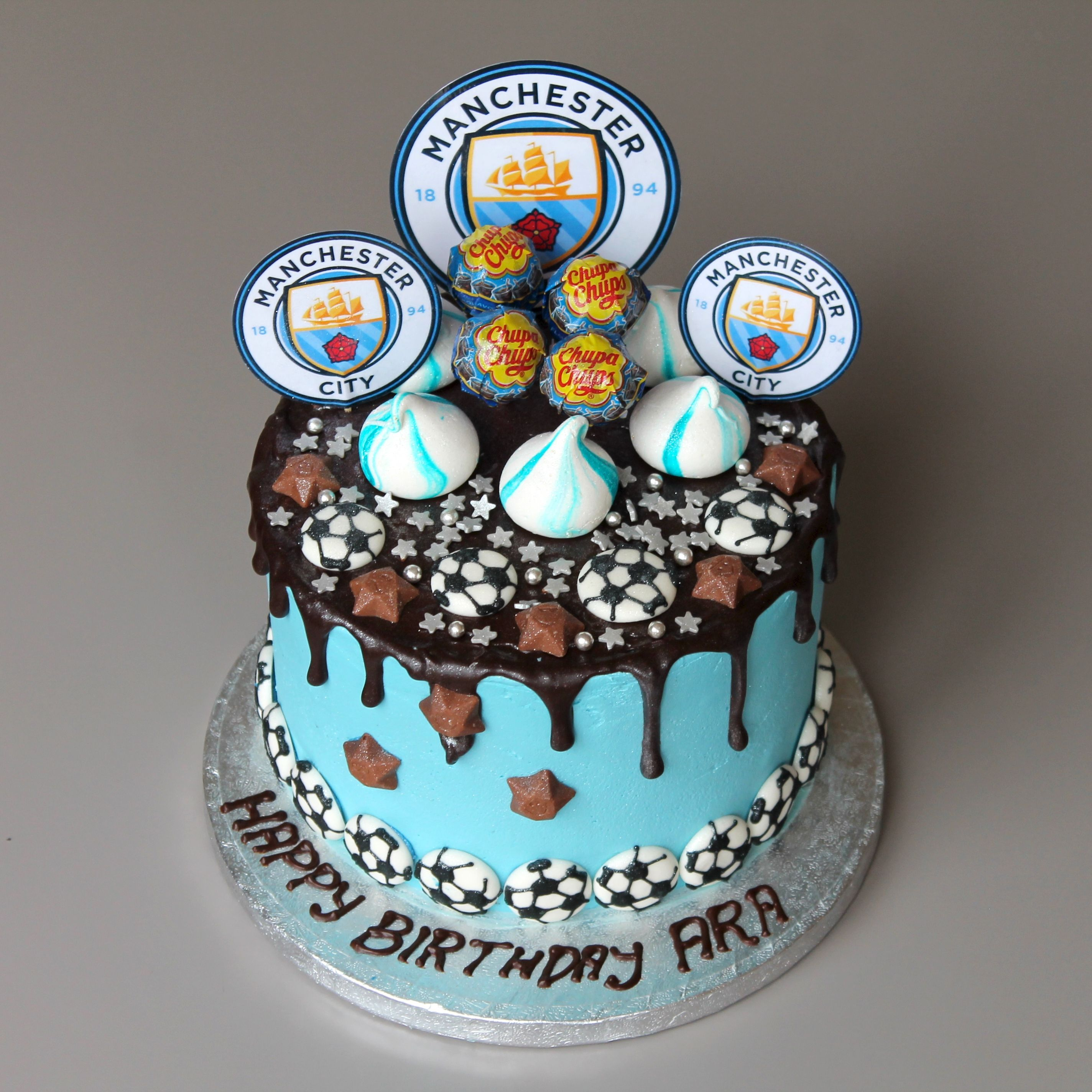 A deliciously light sponge cake coated in MCFC's blue ...