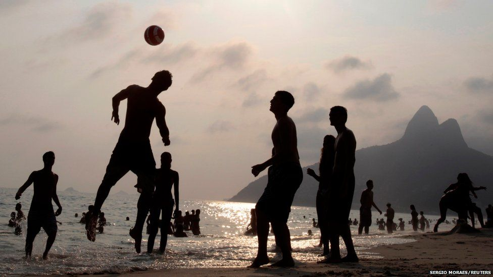 People play football on Ipanema beach during a summer's day in Rio de Janeiro