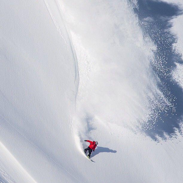 Gigi Ruff fast big powder turn. Photo by Andy Wright  #snowboard