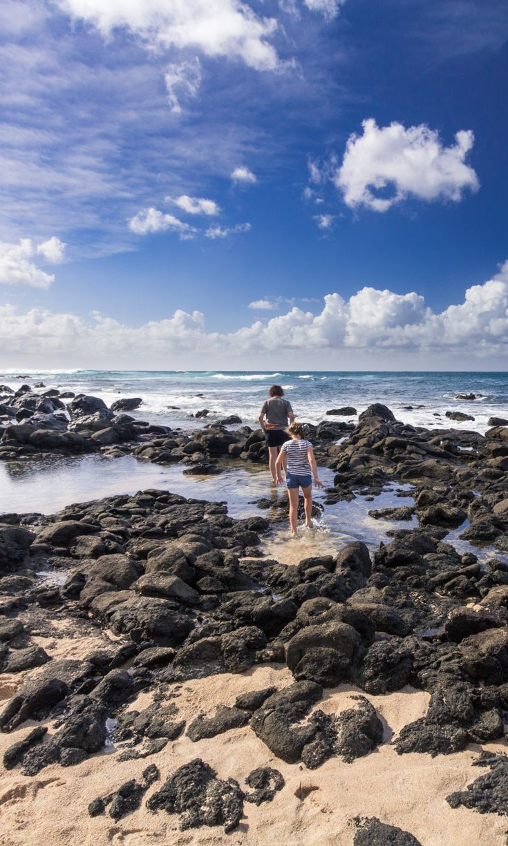 Oahu's North Shore in Hawaii is a great spot to explore with kids. Watch the surfers on the Bonzai Pipeline, stroll along the beach, then grab some shave ice when you're done. Perfect. | Hawaii with Kids | Family Travel