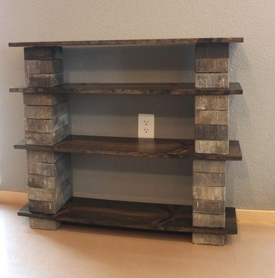 Cheapest, easiest DIY bookshelf ever — concrete blocks (decorative pavers in your color choice and style) with wood. No hammers, cutting or anything!