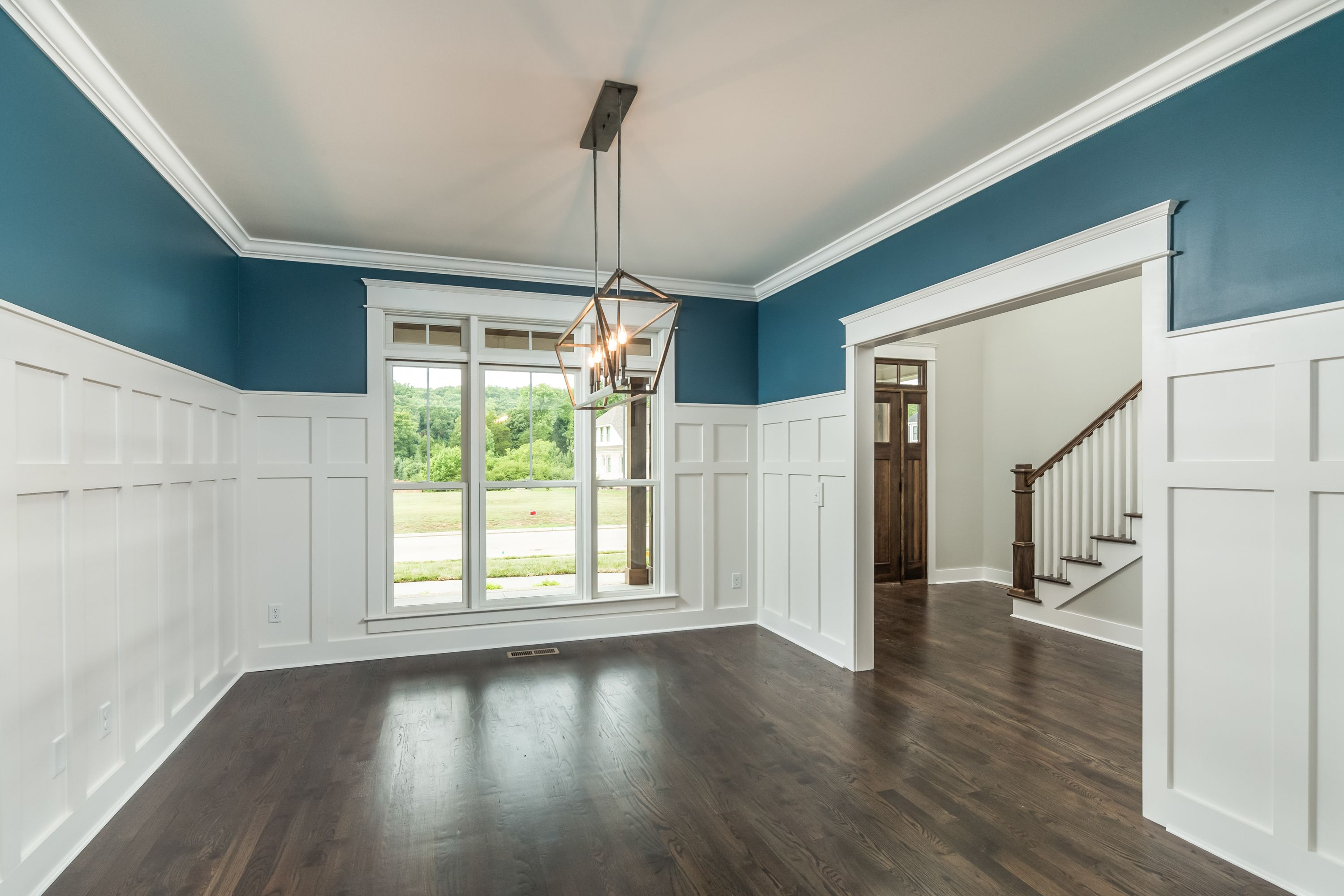 Beautiful Craftsman Style Trim Work With A Soothing Blue Paint In The Dining Room Area
