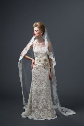 Lace Wedding Dress.. I know I have my sash, but I really Like the flower detail.