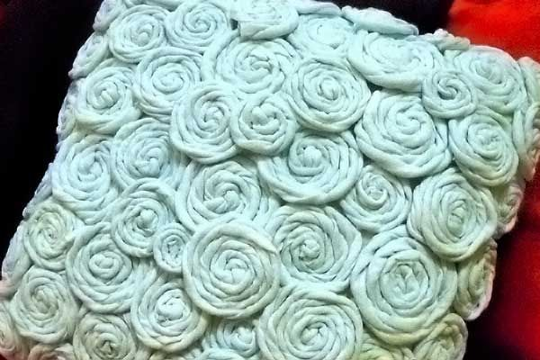 Recycle old T-shirts into a rosette throw pillow~