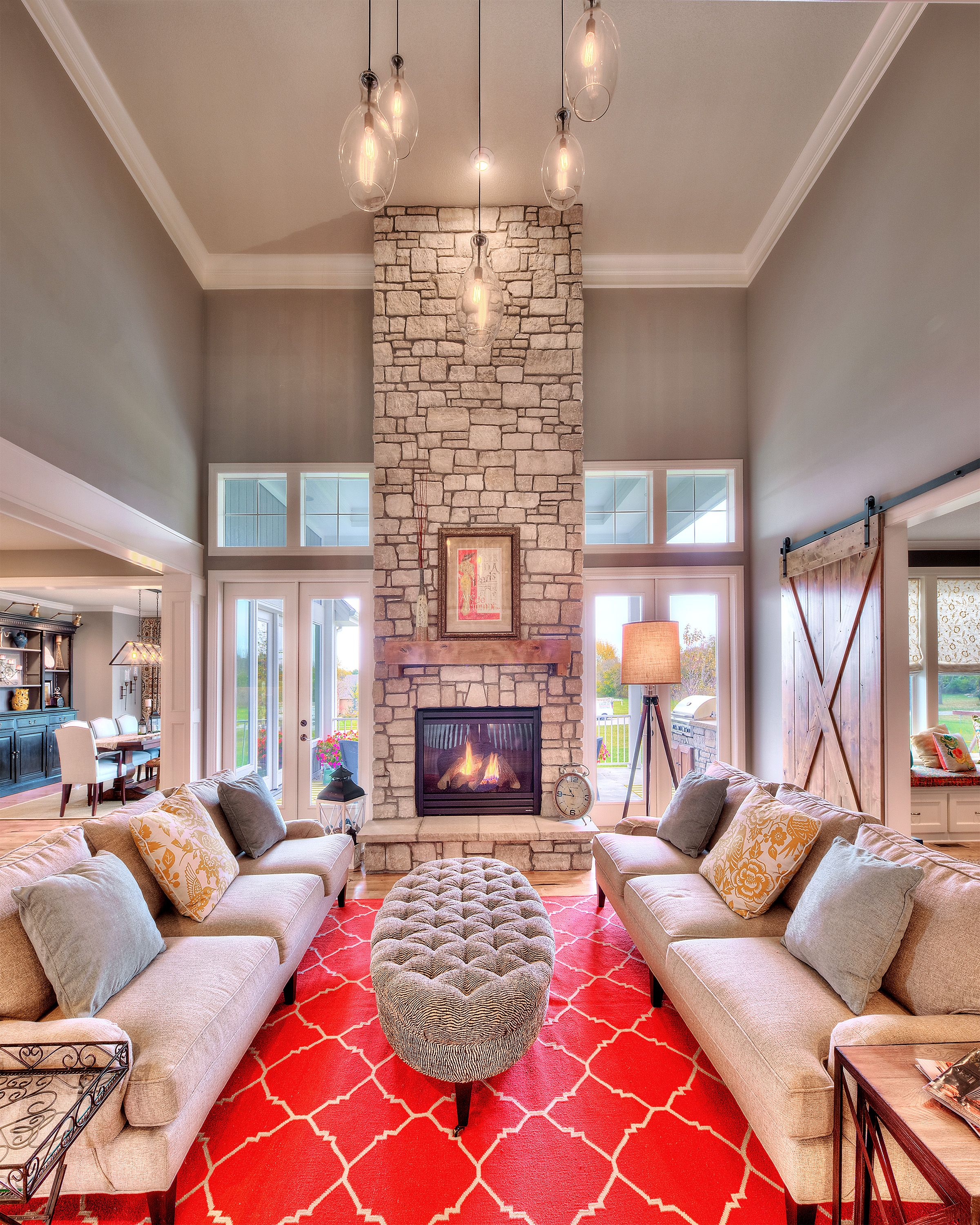 sweet how to decorate an open floor plan. Starr Homes  Cottonwood III Hearthroom floor to ceiling fireplace stone hanging lights large
