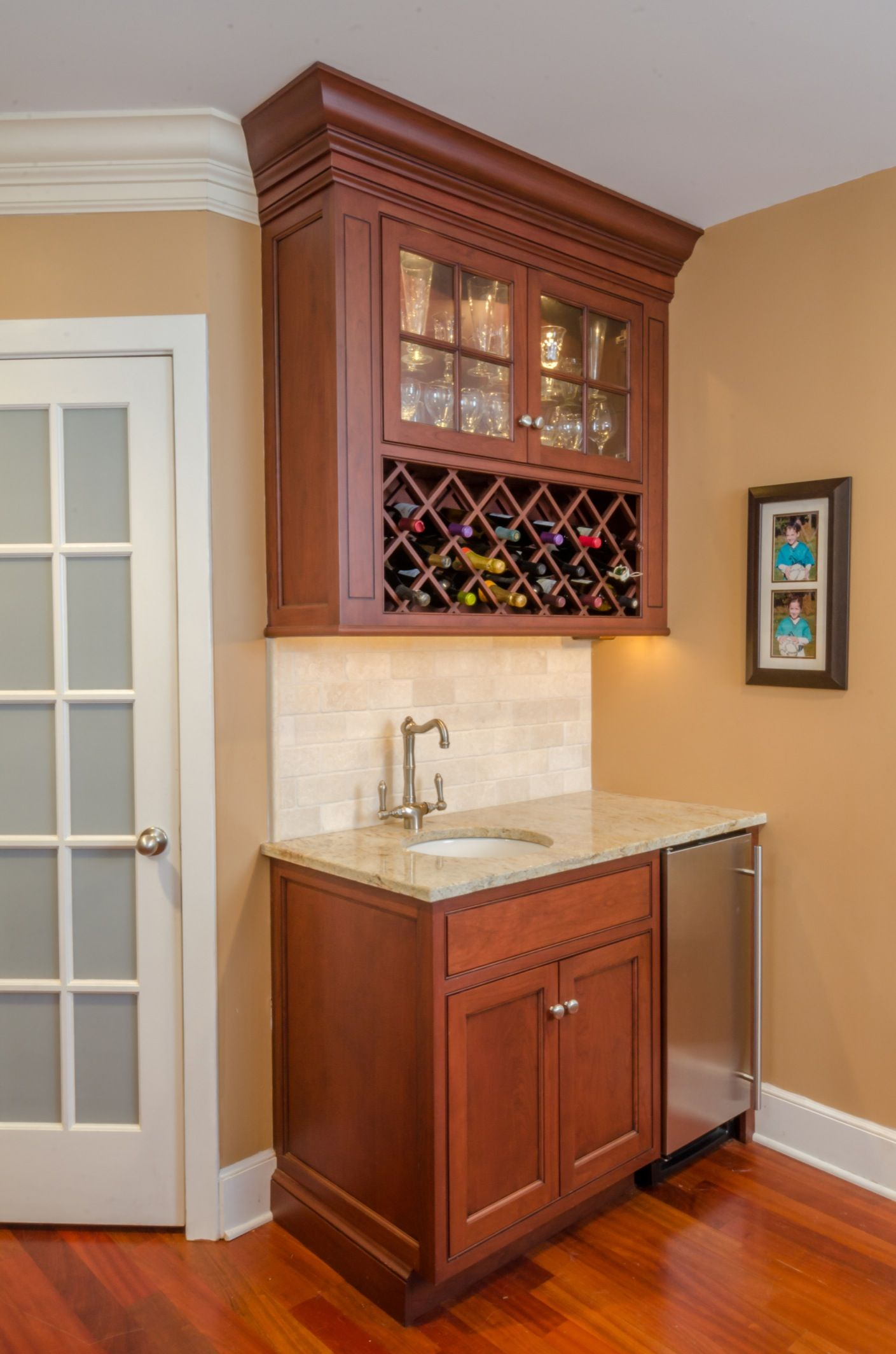 Small Cherry Wet Bar With An Undercounter Refrigerator And