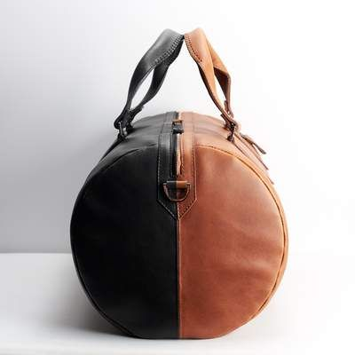 0c293bc3dd02ec Dual Color Duffle Bag · Black & Tan by Capra Leather Limited edition  product with a unique design. Two color travel bag for men.