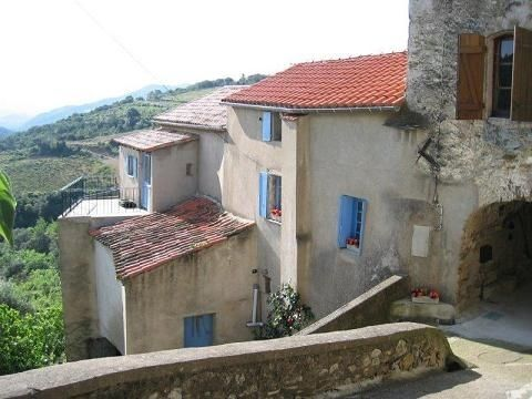 Price: EUR 176,000. For Sale in Saint Chinian, Languedoc Roussillon. Detached XVII century village house, with 2 small gardens and a terrace with breath-taking panoramic views over the surrounding vines and garrigue covered hills, offering about 100 m² of living space and several stone cellars that could be converted into additionnal living space. The house is sold furnished.