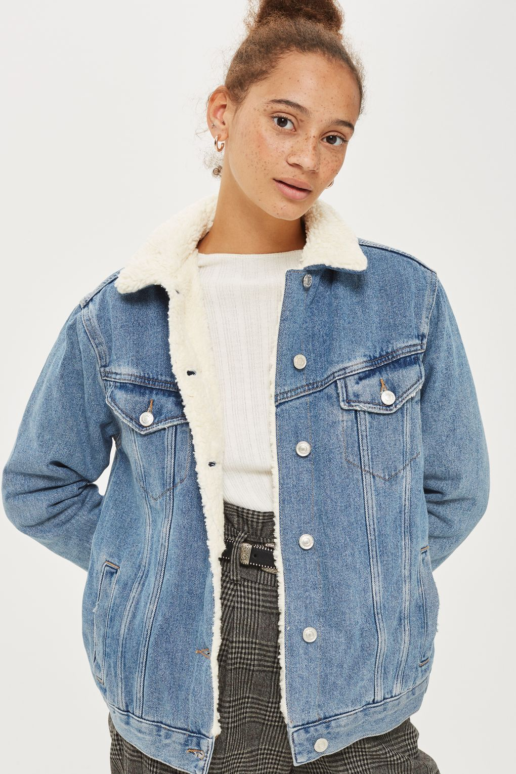 325ca7ea08a In washed blue denim this oversized jacket is a key new season look. Styled  with a plush cream borg collar and lining, it comes with buttons through  the ...