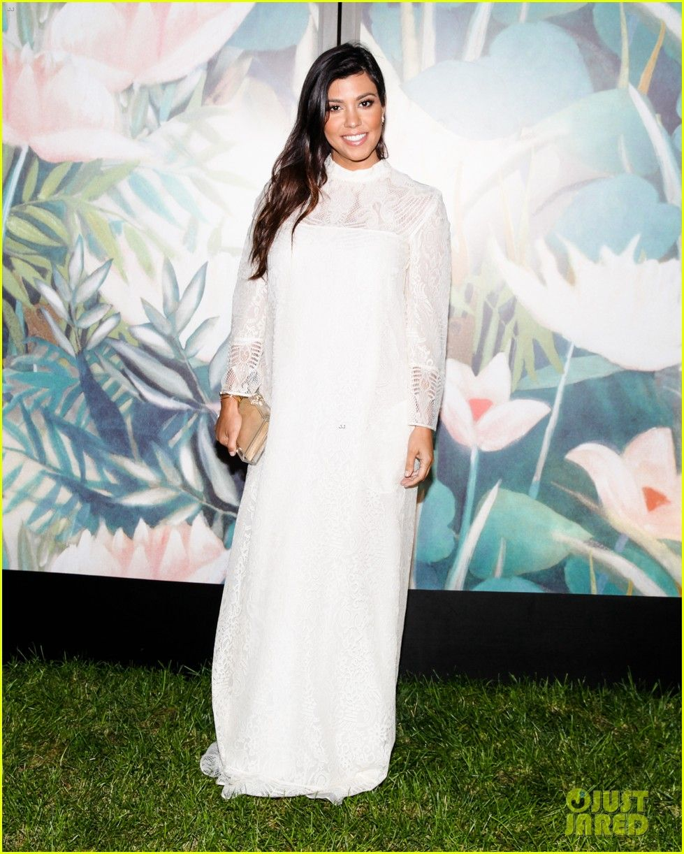 Kourtney Kardashian looks ethereal in a long-sleeved white dress while attending the 2014 Baby Buggy Summer Dinner on Saturday evening (July 26)