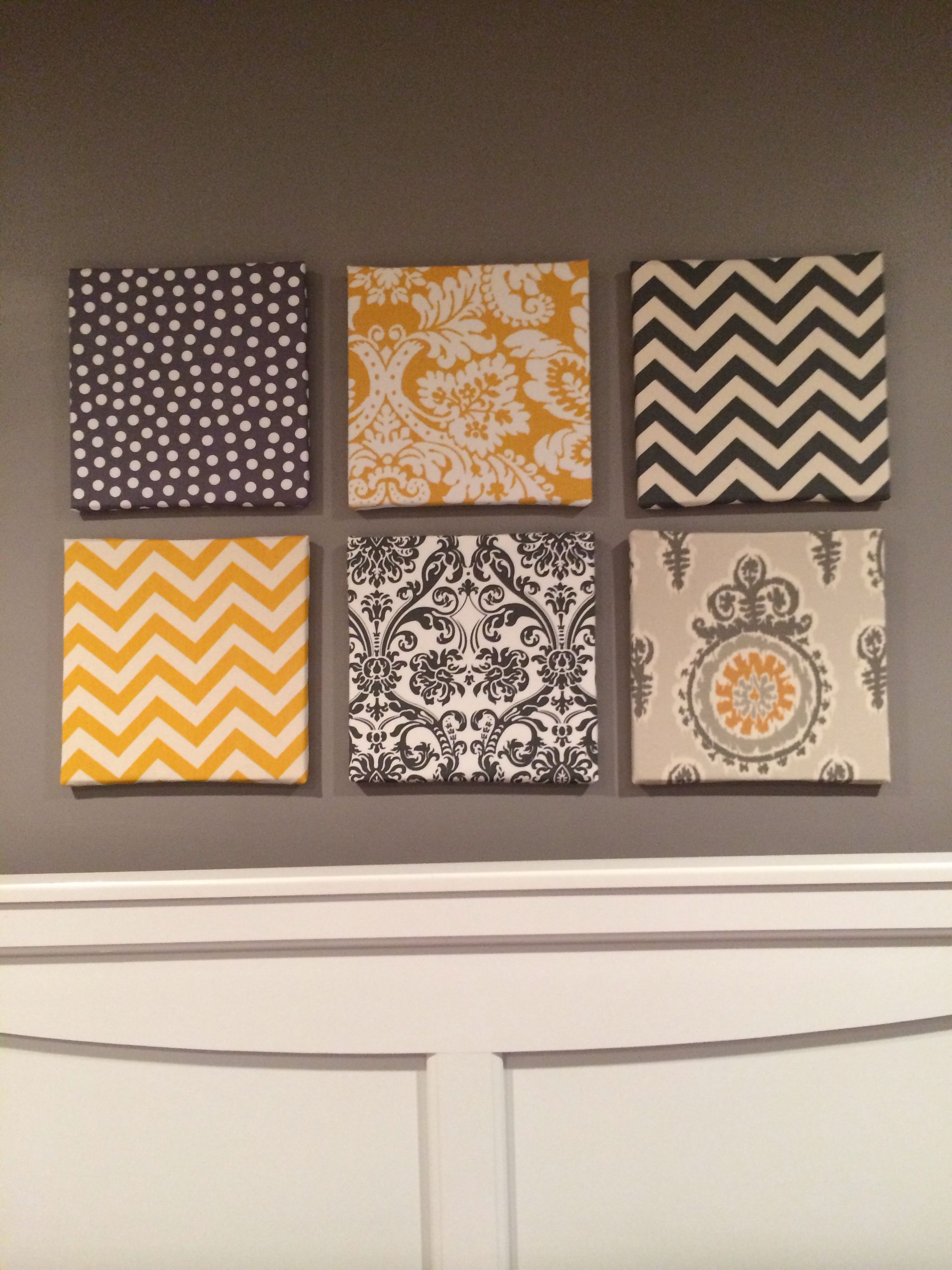 My fabric over canvas wall art for my gray and yellow themed room