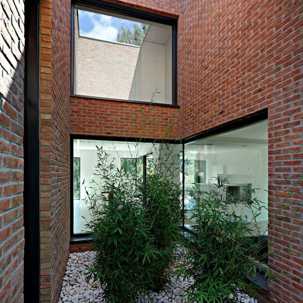 House impressive brick monolithic home with minimalist interiors podfuscak residence