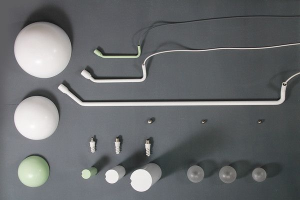 """Kalimero lamp by Kaschkasch.  """"Kalimero lamp is a floor and a table lamp. The lampshade is fixed on the globe through magnet power, so it is possible to pan it in nearly every direction. The lamp consists of 3 parts… the lamp stand, the lampshade and the tube with bulb and fitting – Visually so simple and highly-technical at the same time…"""""""
