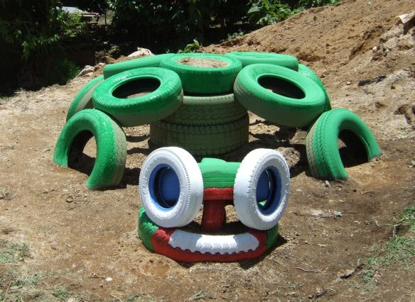 The turtle recycled tire playground kids belong outside for Tire play structure