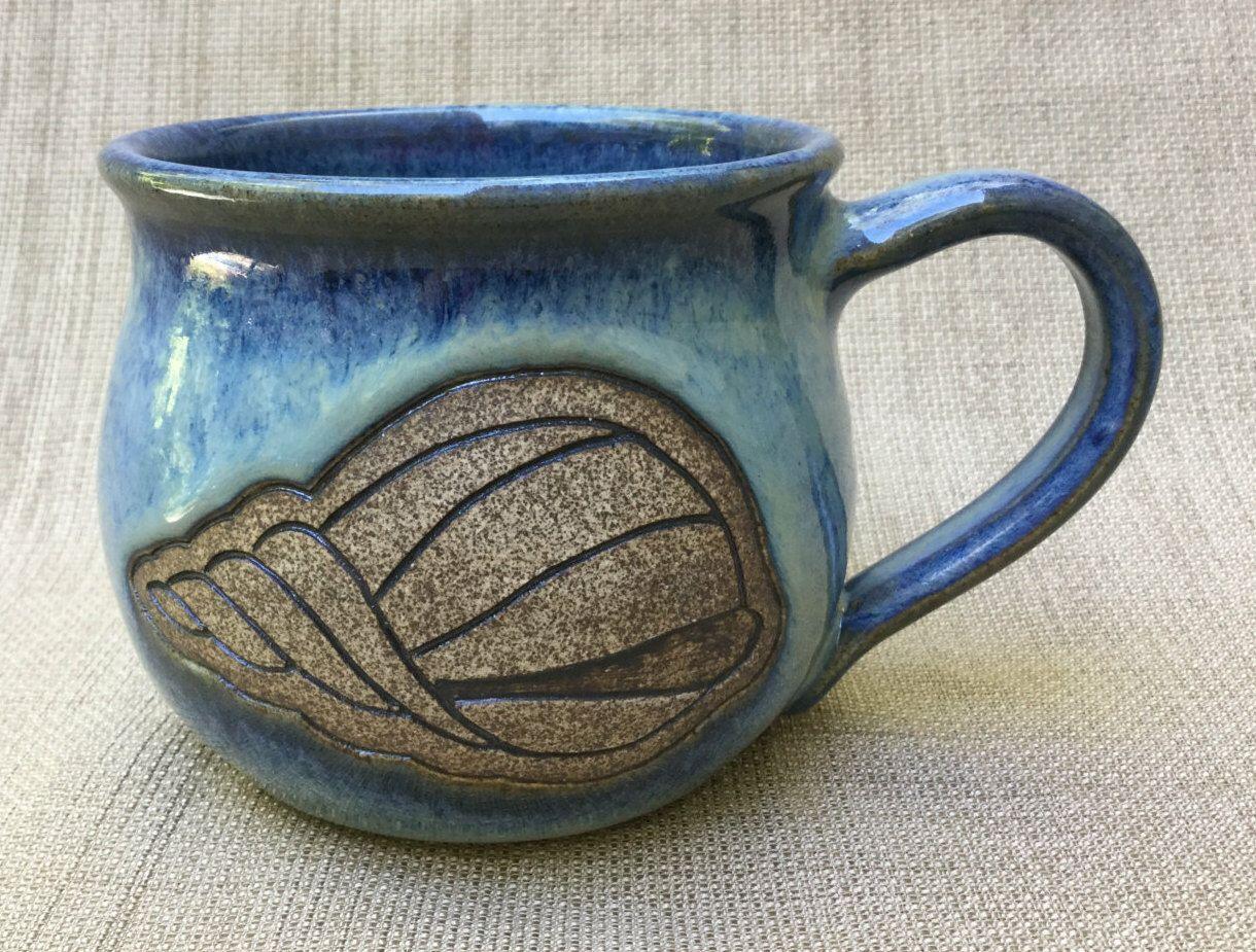 Large Blue/Green Mug with Carved Shell, Carved Mug, Coffee Mug, Tea Cup, Ceramic Mug by StonebridgePottery on Etsy https://www.etsy.com/ca/listing/470911242/large-bluegreen-mug-with-carved-shell
