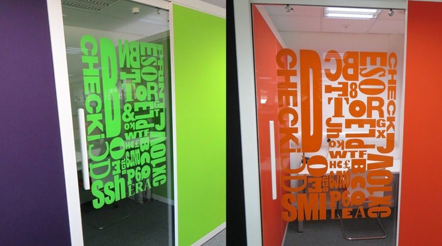 close up of coloured vinyl letters applied to glass wall