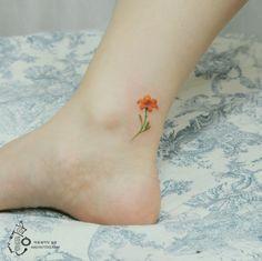 Small Orange Tiger Lily Tattoo On Arm Google Search Tattoo