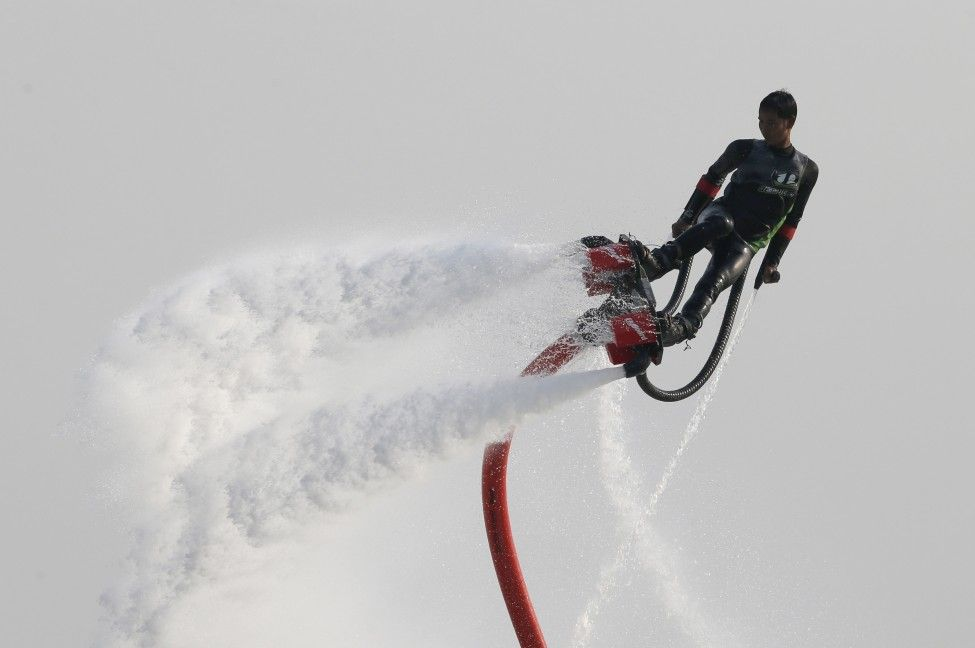 Srirang Sataporn of Thailand takes part in the Fly Board World Championship qualifier in Doha, Qatar. (Reuters)
